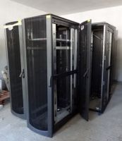 Compaq 10000 series 42RU equipment rack with front and back doors.wheels