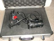 Sachtler 50H reporter light with mains power supply.